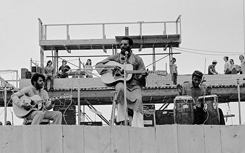 Deano Williams, Richie Havens, and Daniel Ben Zebulon on-stage at Woodstock (Photo by Doug Lenier. Bethel Woods Collection, a gift of Doug Lenier)