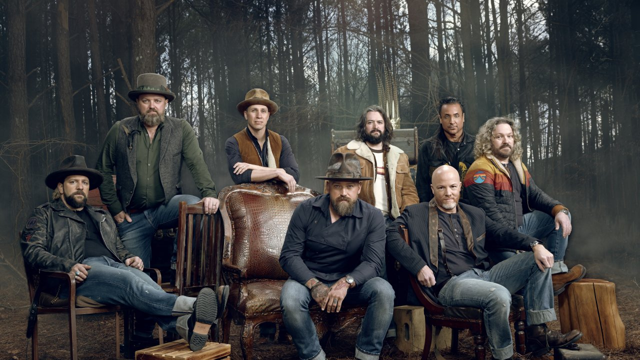 zac brown band sitting on a couch outside