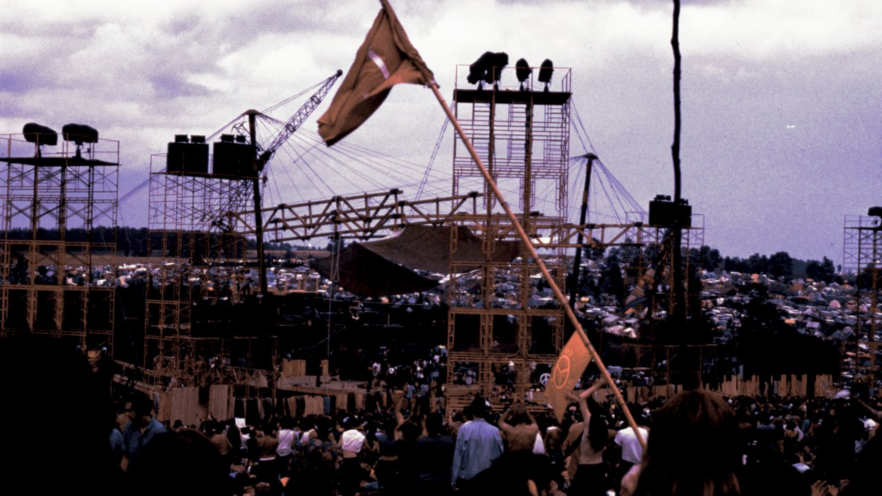 flag being raised at woodstock festival