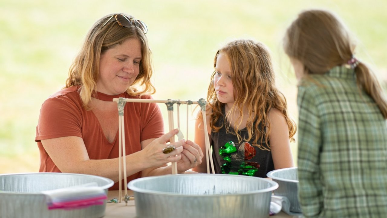 mother and daughter making crafts together at a family program at Bethel Woods