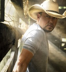 Jason Aldean with a sun flare going across his face