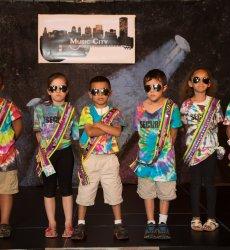 kids in tye dye standing on stage