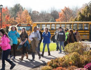 students getting off bus to attend a school program at Bethel Woods