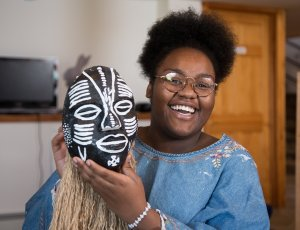female teen participating in a teens program at Bethel Woods holding mask