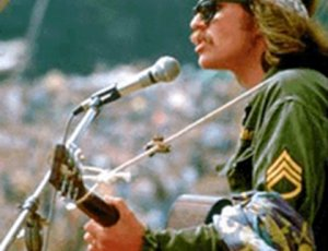 Country Joe McDonald performing at Woodstock