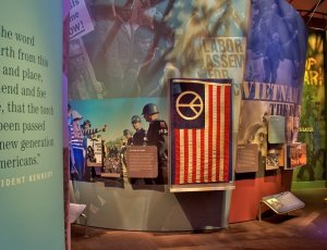 exhibits at museum at bethel woods showing a quote from John F Kennedy and Vietnam memorabilia
