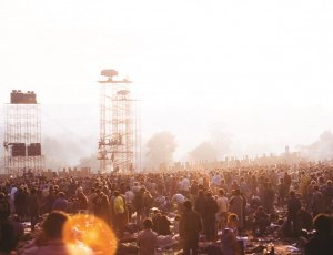 Woodstock photograph with crowd and sound towers taken by Jim Shelley