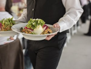 server carrying plates of food