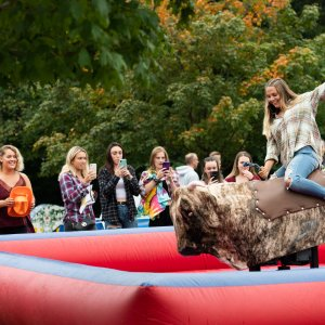 girl riding a mechanical bull