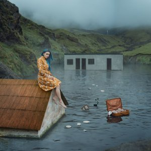 girl sitting on house as it sinks