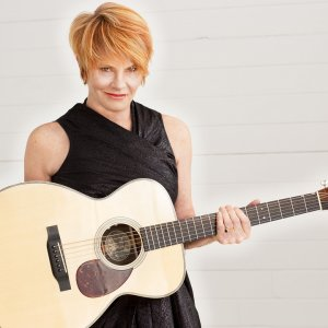 Shawn Colvin holding an acoustic guitar