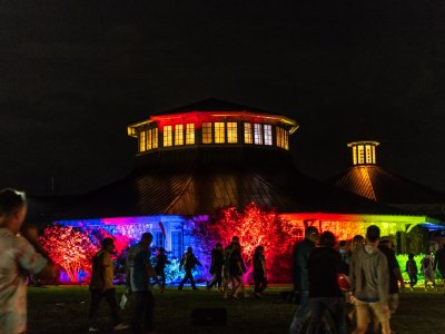 exterior of museum at night lit up with colorful lights