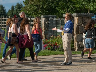 volunteer at Bethel Woods welcoming visitors to a concert