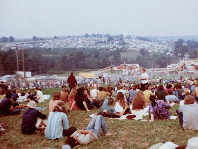 Woodstock attendees sitting on lawn